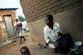A women prepares some food for her child outside his home in the high density area of Epworth in the outskirts of Harare Zimbabwe. Power and water cuts are very common and people have to light fires i... - Felipe Trueba - 21-11-2007