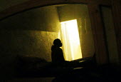A prostitute reflected in the mirror of her hotel room in central Harare. - Felipe Trueba - 2000s,2007,common,EQUALITY,excluded,exclusion,exploitation,FEMALE,HARDSHIP,hotel,HOTELS,impoverished,impoverishment,INEQUALITY,Informal Economy,Marginalised,mirror,people,person,persons,POOR,poverty,p