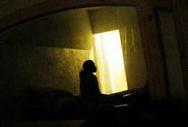 A prostitute reflected in the mirror of her hotel room in central Harare. - Felipe Trueba - 21-11-2007