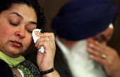 Relatives of murdered Sikh waiter Surjit Singh Chhokar break down at a rally in Glasgow calling for a new public inquiry into his death. Sister Manjit Kaur and father Darshan Singh Chhokar have withdr... - Gerry McCann - 2000s,2001,ASIAN,ASIANS,BAME,BAMEs,bigotry,Black,BME,bmes,break,Chokar,cry,crying,death,DEATHS,died,DISCRIMINATION,diversity,emotion,emotional,emotions,equal,equality,ethnic,ethnicity,feeling,feelings