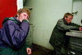 A homeless man prepares to spend the night in the bin shelter of a block of flats in Glasgow. He lives with his brother on the streets and both admit to abusing heroin. - Gerry McCann - 22-09-2002