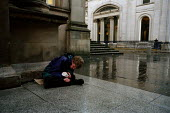 A young man begs outside the Gallery of Modern Art in Glasgow. He has passed out after injecting heroin and lives rough on the streets with his brother. - Gerry McCann - 22-09-2002