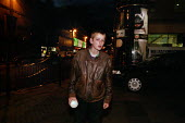 A youth claiming to be 17 but looking much younger, begs in City Centre at Midnight. He also has a wound in his ankle caused by a dirty needle. Glasgow. - Gerry McCann - 22-08-2002
