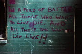 Graffiti found in a disused factory now used for rough sleeping by homeless people in Glasgow. In a field of battle all those who want to live die and those who want to die live! - Gerry McCann - 22-07-2002
