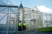 Police. Dungavel Prison near Strathaven in Scotland. The privately run prison is being used as a detention centre for asylum seekers. - Gerry McCann - 2000s,2002,Asylum Seeker,Asylum Seeker,Barbed Wire,center,centre,CLJ law & justice,deportation,deportations,deporting,detained,detainee,detainees,detention,Detention Centre,Diaspora,displaced,Dungavel