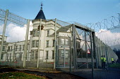 Dungavel Prison near Strathaven in Scotland. The privately run prison is being used as a detention centre for asylum seekers. - Gerry McCann - 2000s,2002,Asylum Seeker,Asylum Seeker,Barbed Wire,center,centre,CLJ law & justice,deportation,deportations,deporting,detained,detainee,detainees,detention,Detention Centre,Diaspora,displaced,Dungavel