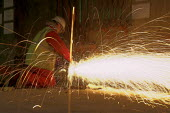Sparks fly as a Construction worker uses an angle grinding machine - Geoff Crawford - 25-01-2006