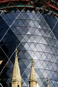Overshadowing the church of St Andrews Undershaft, the Swiss Re Building on the site of the Baltic Exchange at 30 St Mary Axe. AT 40 floors high, the building will be 590 ft/179.8 metres high. It is d... - Geoff Crawford - 12-11-2002