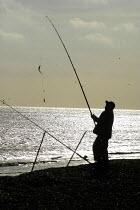 Fisherman in sillhouette, seaside. - Geoff Crawford - 14-01-2003