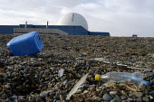 Sizewell B Power Station, Suffolk, a Pressurized water reactor and the polluted beach. The word Danger can be seen on the dome where it was painted by Greenpeace protesters earlier when they staged a... - Geoff Crawford - 14-01-2003