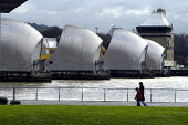 The Thames Barrier. A woman and child walk along the bank of the riverThames - Geoff Crawford - 02-01-2003
