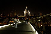 Pedestrians crossing The Millenium Bridge at night with the Tate Modern in the background. - Geoff Crawford - 11-01-2003