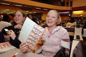 Young woman playing bingo at the Gala Club in Leyton, East London, UK - Geoff Crawford - 02-04-2003