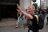 Preacher Phil Howard exercises his right to free speech at Oxford Street. His mission is to 'make London the safest capital in the world.' - Geoff Crawford - 04-07-2003