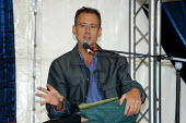 Gay rights activist and campaigner Peter Tatchell speaking at Greenbelt Festival August 2003 - Geoff Crawford - 2000s,2003,activist,ACTIVISTS,CAMPAIGN,campaigner,campaigners,CAMPAIGNING,CAMPAIGNS,equal,Festival,FESTIVALS,finger,gay,gays,Greenbelt,homosexual,homosexuality,homosexuals,Human Rights,injustice,LGBT,