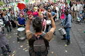Drummers play outside the Headquarters of DEFRA in Smith square during a protest march against GM food production in London. Red placard reads - Fork Off Our Food. October 13th 2003 - Geoff Crawford - 13-10-2003