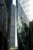 The Swiss Re building near the Natwest Tower in the heart of the City of London. On the site of the Baltic Exchange at 30 St Mary Axe, the 40 floor building stands 590 ft/179.8 metres high. - Geoff Crawford - 2000s,2004,30,ACE,ACE arts,architecture,arts,Axe,Baltic,Bank,BANKS,Blue Sky,building,buildings,by,cities,City,Construction,culture,EBF economy business,Exchange,finance,FINANCIAL,floor,insurance,Londo