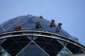 Workmen abseiling down the roof of the Swiss Re building. On the site of the Baltic Exchange at 30 St Mary Axe, the 40 floor building stands 590 ft/179.8 metres high. - Geoff Crawford - 2000s,2004,30,abseiling,ACE,ACE arts,architecture,arts,Axe,Baltic,Blue Sky,building,buildings,by,cities,City,Construction,culture,danger,dangerous,EBF economy business,Exchange,finance,FINANCIAL,floor