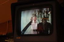 Underground passengers on CCTV surveillance monitors at Highbury & Islington underground station. - Geoff Crawford - ,2000s,2004,anti social behavior,anti social behaviour,anti socialanti social behavior,antisocial,antisocial behaviour,behavior,behaviour,cctv,circuit,CLJ crime,closed,closing,closure,closures,communi