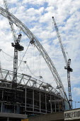 Construction of the New Wembley Stadium. Despite predicting a �45m loss on the project. Multiplex, the Australian property firm building the stadium has insisted it will be finished in time for the FA... - Geoff Crawford - 03-06-2005