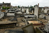 Damaged gravestones at West Ham Jewish cemetery in Stratford, east London. Over 80 stones were pushed over and the door to the Rothschild family mausoleum was smashed in a racist attack - Geoff Crawford - 16-06-2005