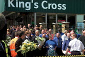 Religious leaders and underground workers join other mourners at Kings Cross for a two minutes silence, one week after the terrorist bombings in London. - Geoff Crawford - 14-07-2005