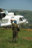 UN Soldier with helicopter at Mongbwalu airstrip, Democratic Republic of Congo. Congo is preparing for what should be the first free presidential elections since independence 45 years ago - Geoff Crawford - 22-06-2006