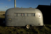 Airstream American style vintage caravan, Dungeness, Kent, UK - Geoff Crawford - (,(STA),2000s,2008,Airstream,American,americans,Area,beach,BEACHES,caravan,caravans,Coast,coastal,coasts,Conservation,country,countryside,Dungeness,England,for,garden,GARDENS,holiday,holiday maker,hol