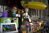 Church goers drink fairtrade tea behind a stall selling fairtrade produce at St Mary the Virgin church in Ashford, Kent. - Geoff Crawford - 09-02-2008