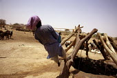 Nomadic Tuareg shepherd draws water from a deep well at Mini Mini, Niger. Niger and neighbouring countriesare experiencing severe drought. 3.6 million people are facing food shortages in Niger alone a... - Geoff Crawford - 02-11-1997