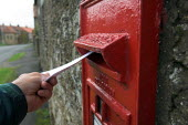 Posting a letter in Sawdon village, North Yorkshire Moors - Geoff Crawford - ,2000s,2005,box,boxes,communicating,communication,EBF Economy,hand,highway,isolated,isolation,letter,Letter box,Letter boxes,Letterbox,Letterboxes,letters,MAIL,Moors,North,pillar,post,Post Office,post