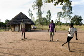 Boys play football with a rag ball in Norungatuny village in the Amuria district of Uganda near Soroti. - Geoff Crawford - 08-02-2010