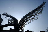 Angel Wings, a sculpture at the N1 shopping centre, Angel Islington, London - Geoff Crawford - 2000s,2003,ACE arts culture,Angel,art,artwork,artworks,bought,Buttress,buy,buyer,buyers,buying,cities,city,commodities,commodity,consumer,consumers,customer,customers,Fine Art,flight,FLIGHTS,flying,go