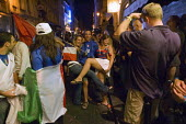 Italian football fans celebrating World Cup victory on the streets of Paris - Graham Howard - 2000s,2006,amateur,at,Celebrate,celebrating,cities,city,Cup,EMOTION,EMOTIONAL,EMOTIONS,eu,Europe,european,europeans,eurozone,fan,fans,FEMALE,flag,flags,football,France,french,HAPPINESS,happy,Italian,J