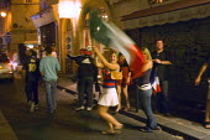 Italian football fans celebrating World Cup victory on the streets of Paris - Graham Howard - 2000s,2006,Celebrate,celebrating,Cup,EMOTION,EMOTIONAL,EMOTIONS,eu,Europe,european,europeans,eurozone,fan,fans,flag,flags,football,France,french,HAPPINESS,happy,Italian,Joy,joyful,Night,Paris,scene,sc