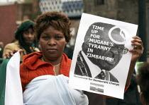 Anti Mugabe protest on a Anti-war rally in Glasgow. - Gerry McCann - 15-03-2008
