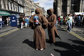 Thousands of street performers like these actors dressed as monks publicise their shows in the Royal Mile during the Edinburgh Festival. - Gerry McCann - 2000s,2006,ace art arts culture,artist,artists,comedian,comedians,comedy,ENTERTAINER,ENTERTAINERS,funny,humor,HUMOROUS,HUMOUR,JOKE,JOKES,joking,monk,monks,performance,performer,performers,scene,scenes