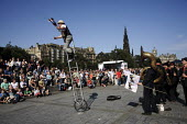 Street performers include jugglers and acrobats and singers during the Edinburgh Festival. - Gerry McCann - 2000s,2006,ace art arts culture,artist,artists,performance,performer,performers,scene,scenes,Scotland,Scottish,street,streets