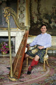 Torquhil Ian Campbell otherwise known as the Duke of Argyll, wearing a kilt and photographed at Inverary Castle, Argyll, Scotland. - Gerry McCann - 2000s,2006,ace culture,AFFLUENCE,AFFLUENT,Bourgeoisie,Campbell,Campbells,Castle,Chief,Chiefs,Clan,class,elite,elitism,EQUALITY,gentry,harp,HARPIST,HARPISTS,harps,high,high income,home,housing,income,I