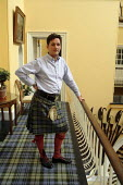 Torquhil Ian Campbell otherwise known as the Duke of Argyll, wearing a kilt and photographed at Inverary Castle, Argyll, Scotland. - Gerry McCann - 2000s,2006,ace culture,AFFLUENCE,AFFLUENT,Bourgeoisie,Campbell,Campbells,Castle,Chief,Chiefs,Clan,class,elite,elitism,EQUALITY,gentry,high,high income,home,housing,income,INCOMES,INEQUALITY,laird,land