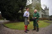Torquhil Ian Campbell otherwise known as the Duke of Argyll, wearing a kilt and photographed with his gardener at Inverary Castle, Argyll, Scotland. - Gerry McCann - 19-05-2006