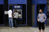 Members of the public use cash machines or ATMs owned by the Royal Bank of Scotland, in Glasgow city centre. - Gerry McCann - 07-06-2006