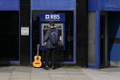 Members of the public use RBS cash machines or ATMs owned by the Royal Bank of Scotland, in Glasgow city centre. - Gerry McCann - 07-06-2006
