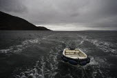 The main transport from Mallaig to the Knoydart Peninsula in North-West Scotland is by the Western Isles which is also the post boat. It tows a dinghy for difficult landing sites. - Gerry McCann - 03-05-2006