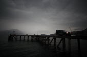 A thunderstorm engulfs the old pier at Inverie on the Knoydart Peninsula. It was demolished in August 2006 after the new pier opened. - Gerry McCann - 04-05-2006