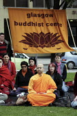 Several hundred people demonstrate in Glasgow against the repression in Burma. Many wore red and chanted and meditated. They lit candles. They were led by Venerable K. Sri Rewatha Thera. - Gerry McCann - 06-10-2007