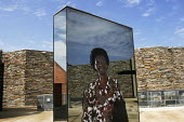 Mirrored artworks depicting the country's ethnic diversity, on the roof of the Apartheid Museum in Johannesburg, South Africa. - Gerry McCann - 20-04-2005