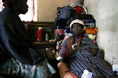 A woman and her extended family are receiving advice from a trained counsellor on the use of antiretroviral drugs. At a community-based scheme in a rural shanty town to support children orphaned by AI... - Gerry McCann - ,(AIDS),(HIV),/,2000s,2005,Acquired,Acquired immune,advice,advices,ADVISE,adviser,advisers,advising,ADVISOR,ADVISORS,AIDS,Antiretroviral,bed,beds,care,caring,CHILD,CHILDHOOD,children,communicating,com