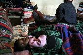 A woman and her extended family are receiving advice from a trained counsellor on the use of antiretroviral drugs. At a community-based scheme in a rural shanty town to support children orphaned by AI... - Gerry McCann - ,(AIDS),(HIV),/,2000s,2005,Acquired,Acquired immune,advice,ADVISE,AIDS,apparel,asleep,bed,bedding,beds,care,carer,carers,caring,child,childcare,CHILDHOOD,CHILDMINDING,children,clothes,clothing,communi