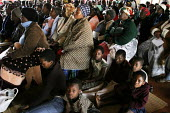 A public awareness meeting held in a rural village hall, at a community-based scheme in a rural shanty town to support children orphaned by AIDS and related illnesses. Organised by SWAPOL (Swaziland f... - Gerry McCann - ,(AIDS),(HIV),/,2000s,2005,Acquired,Acquired immune,AIDS,audience,audiences,boy,boys,campaign,CAMPAIGNING,CAMPAIGNS,child,CHILDHOOD,children,communities,community,crowd,crowds,deficiency,deficiency sy